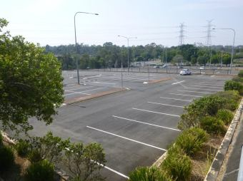 On weekends, holidays, and after hours, the car park is a baking empty expanse.